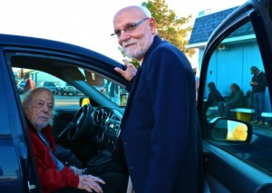 Jack Curtain, long time volunteer visits with Peter Rinn, Project Share Executive Director